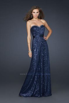 La Femme Prom - 17059 Gorgeous strapless sequin dress will make you shine at prom. Complete with a satin belt and a sweetheart neckline with stones incrusted along the top. http://www.reflectionsbridalandprom.com/detail.php?ProdId=6340655&CatId=17646&resPos=562#subtitle $350.00