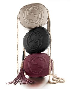 """Gucci metallic leather mini chain bag with embossed interlocking """"G"""" detail. Light golden hardware. Threaded chain shoulder strap with 21"""" drop. Zip closure with leather tassel pull. Interior, natural"""
