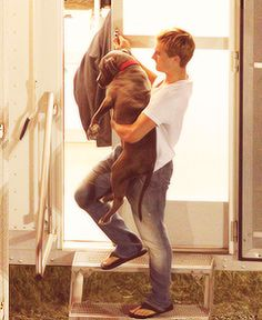 awww.. he brought his puppy to the set, and he carries her down the steps because she's afraid to go down... what a sweetie.