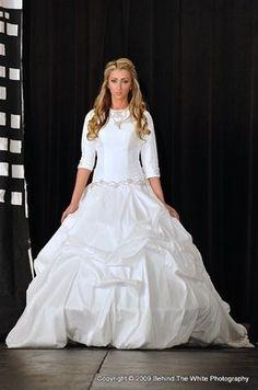 She is too short for this dress...tznius wedding dress