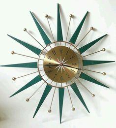 Green starburst teak clock.