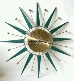 Green starburst teak clock.
