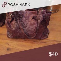 Handbag Jessica Simpson handbag. Beautiful bag.measurement=9.5X18inches. Floral on the inside. Jessica Simpson Bags