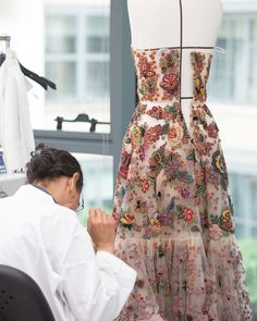 After being carefully hand embroidered in a riot of colorful beads in Mexican-inspired floral motifs, the panels of this Cruise 2019 dress…