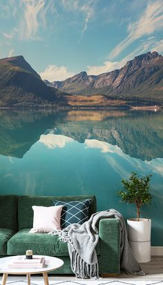 Capture the beauty of the great outdoors right in your living room. This breath-taking view of this Scandinavian landscape boasts beautiful yet subtle turquoise hues. Pair with a jewel-tone green sofa and soft furnishings to complete the look.