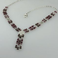 This princess necklace is handmade using cateye and Czech crystal glass. The plum is a rich color of affluence, femininity and wisdom.    The