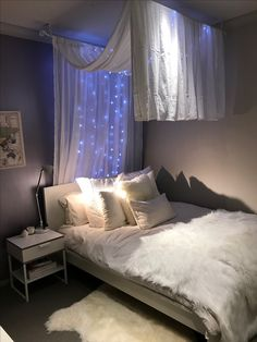 My daughters very grown up room. IKEA Malm queen bed and Trysil bedside table. Canopy made from IKEA two extendable curtain rods and two sets of sheer curtains. Lights from two dollar shop. Feature wall in Porters metallic paint and walls in Dulux Linseed.