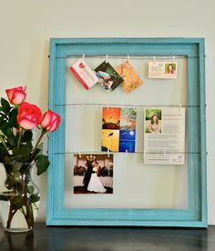 Photo Organizer by HeartsongFineArt I want to be on the look out for an old wooden window frame and paint it perhaps a lighter red to match my curtains and do this with family pictures.