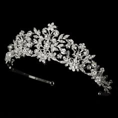 If you want to feel like a real princess as you walk down the aisle on your big day, you're going to need a #tiara that fits the part. Make your grand entrance in true royal fashion by adding this ravishing crystal and pearl bridal tiara to your wedding day ensemble! StressAwayBridalShop.com