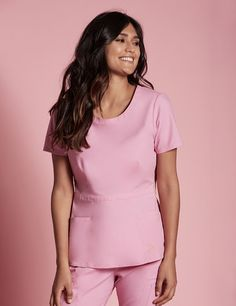 The Peplum Top in Pink is a contemporary addition to women's medical scrub outfits. ShopJaanuufor scrubs, lab coats and other medical apparel.