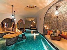 Indoor pool. Love the little seating grottos