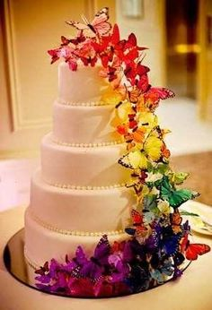 As a way to make a unique statement on your wedding day, butterfly wedding cakes can be a beautiful and memorable choice. Butterfly wedding cakes are a different Butterfly Wedding Cake, Butterfly Cakes, Rainbow Butterfly, Butterfly Wall, Butterfly Colors, Butterfly Dress, Pretty Cakes, Beautiful Cakes, Amazing Cakes