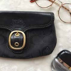 ⚡️ FLASH SALE ⚡️ Coach Black Wristlet Excellent condition. Only wear is in the inside as shown in the last photo. Super cute authentic Coach wristlet! Coach Bags Clutches & Wristlets