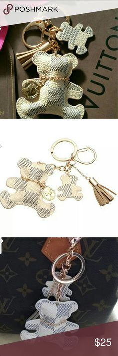 NEW TEDDY BEAR PURSE POM POM-BEIGE New inspired Luis Vutton Damier Azur Bear styled Keychain and or purse pom pom.  Perfect way to accessorize your LV totes, clutches, bags and cell phone cases.  Well constructed.  Bundle your order to save on price or submit your offer   Tags for exposure to use on purses, mk, coach, Luis vutton, Michael kors, gucci, betsy, chanel, hobo, cross body, tote, fossil, satchel, backpack, bag, inspired,LV, bucket,tory burch,Kate spade Accessories