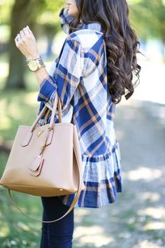 More cute plaid. I like the ruffle to give it a feminine touch. There is nothing like this in my closet.