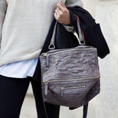 This Givenchy Pandora Bag is crafted of grey distressed sheep leather and is styled with gold-tone logo hardware. Single top handle, and detachable and adjustable shoulder strap. Top zip main compartment, front zip compartment, and bottom zip pocket. Interior zip pocket and slip pocket, logo leather patch, and black canvas lining. 33cm l x 16cm w x 21cm h Handle Drop:18cm/ Shoulder Strap: 100cm Please allow 1-2 weeks for shipping.