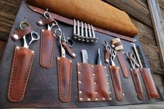 Tool roll barber Dimensions: 12 X 20 fully open. This deluxe leather tool roll will hold a multitude of your hair styling tools. There are 6 scissor p. Leather Holster, Leather Tooling, Barber Apron, Barber Shop Decor, Leather Roll, Tool Roll, Leather Projects, Leather Crafts, Cover Design