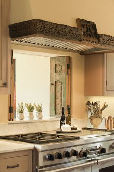 Carved Wood Range Hood and Shutters - LOVE the carved wood over the range when ethnic meets contemporary