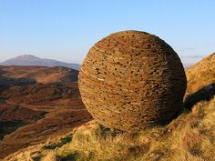 'Globe' by Joe Smith, 'rock art' at the Knockan Craig NNR Interpretative Centre, near Elphin NW Sutherland, Scotland