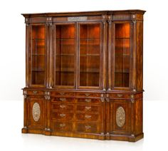 A flame mahogany breakfront library bookcase, the fluted frieze above four glazed doors, enclosing adjustable glass shelves, with four frieze drawers, the centre with four further graduated long drawers flanked by two repoussé panel cabinets each enclosing an adjustable shelf.