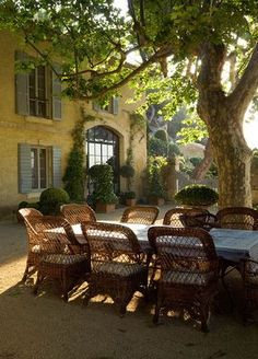 Outdoor dining with wicker chairs.Love!