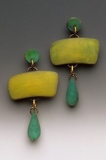 'Map Lauren Earrings' by art jeweler Louise Fischer Cozzi. Etched/painted polymer in translucent colors. via the artist's site