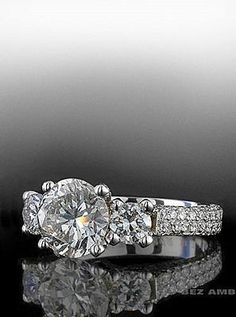 Round Brilliant three stone ring with two row pave band.  By Bez Ambar.  Available at Alson Jewelers.