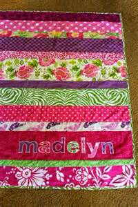 This can be easily done using jelly roll strips and cut some in half then sew a few of the matching strips together to get an off-set stripe pattern. Appliqué the baby's name to personalize it. You can buy ready cut letters in any fabric store.