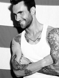 Adam Levine -- he has the pipes to match his bod.  I refrained from pinning the naked picture of him, but i wanted to . . .