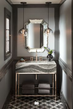 Break the rules and mix your metals. With our Roxwell™ design, we pair rose gold finishes for a modern take on metallics in this bathroom remodel.