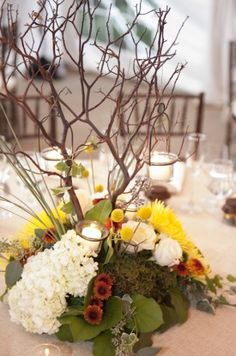 Tree Branch Centerpeices 275x415 Whimsical and Woodsy Wedding Reception at Woodend Sanctuary  GREENWORKS