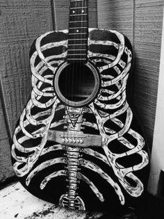 Skeleton guitar. I WANT!