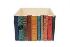 "12""x12""x8"" storage bin created from repurposed library books. $80/bin from Able+Baker."