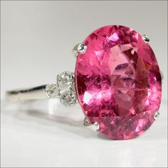 Fab Fifties Pink Tourmaline and Diamond Ring in Platinum, oval cut stone measures 14.65 mm north to south, 11.7 mm across and is 7 mm deep for an approximate carat weight of 7.53.