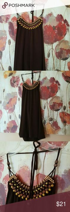 """🌻BROWN SILKY BEADED TANK🌻BUNDLE AND SAVE 20% Dark brown color beaded silky tank top with low cut back, very sexy and cute for summer/fall with shorts, trousers or jeans. Size medium worn only a couple times excellent condition. Materials are 94% polyester and 6% spandex. Length is 22"""" long.🌻 Outback Red  Tops Tank Tops"""