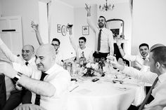 Male wedding guests toast the wedding speeches at Pembroke Lodge Surrey wedding © Fiona Kelly Photography