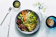 """VIETNAMESE-STYLE SPAGHETTI SQUASH """"NOODLE"""" BOWLS WITH SKIRT STEAK  Spaghetti squash plays the part of traditional rice noodles in this take on a Vietnamese noodle bowl. Roast the squash and marinate the steak the day before, and it's easy to pull off in just half an hour for dinner."""