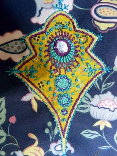 Drapes for Half-Tester.  Embroidered piece with shisha embroidery. Large shisha with asymmetrical fly stitch detail.