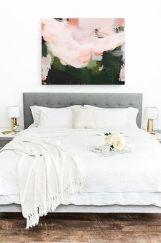 Modern abstract art above the bed