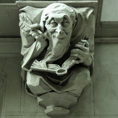 Gargoyle ....a man writing in a ledger: Morningside Heights. The Britannia at 527 West 110th Street. New York