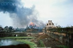 14 Feb 1968, Hue, South Vietnam --- Hue, South Vietnam. Two U.S. Marines watch as bomb goes off in moat surrounding walled citadel. --- Image by © Bettmann/CORBIS