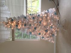 White Christmastree with iceblue and silver ornaments