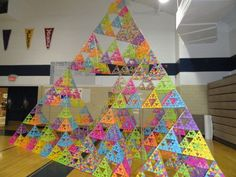 Middle School Builds World's Largest Tetrahedron - Built by the fifth and sixth grade students, this Rainbow Tetrahedron contains 21,000 individual pyramids. The structure is 16 feet tall. | #Art #Sculpture #Pyramids |