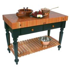 """The John Boos table """"Le Rustica"""" can be used as an accent piece of furniture anywhere in your home or would be a stunning kitchen island.   The slat wood shelf provides ample storage for bulky items. The under-top drawers provide space for utensils."""