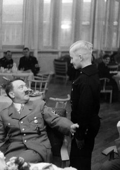 Adolf Hitler meets young disciple and future soldier for the Fatherland. His expression -- that of the Father of all Germany -- tells the whole story (that ended in unimaginable horror).