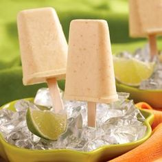Blend: 1 can pineapple w/ juice, 1 banana, 1 can coconut milk, 1/2 tsp vanilla. Freeze in pops. 117 calories per pop.