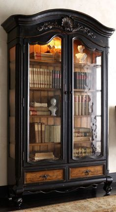 I LOVE this! I think I could make it from a china cabinet. Line the back with bead board, replace the glass shelves with wood and paint/stain the exterior.