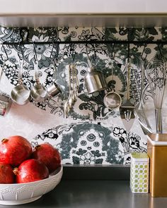 Maximize storage - hang pretty stainless kitchen tools that are used regularly for easy access.