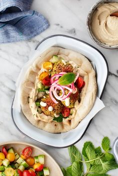 Learn how to make falafel with this easy baked falafel recipe! Made with chickpeas, herbs, and spices, it's crispy, zesty, and delicious.