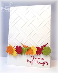 handmade card ... CASology: Week #14: LEAF ... white card with row of die cut and embossed little leaves in Fall colors ... (would luv to see this with a kraft base) ... texture and interest from embossing folder trellis pattern ... delightful card!!